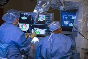 Doctors in the operating room at Aurora St. Luke's Medical Center, of which the Aurora Neurosciences Innovation Institute is a part, rely on brain mapping images created by neuroradiologists who are part of the program.