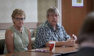 Lung cancer patient Robyn Shank and her husband, Fred, listen intently as Robyn's doctors discuss her CT scan and potential course of treatment as part of Elkhart General Hospital's Thoracic Oncology Clinic. The weekly conferences give patients and their family members a seat at the table to plan their care.